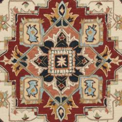 Hand-hooked Heriz Red/ Ivory Wool Rug (5'6 Round)