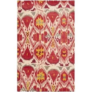 Handmade Ikat Ivory/ Red Wool Rug (8' x 10')