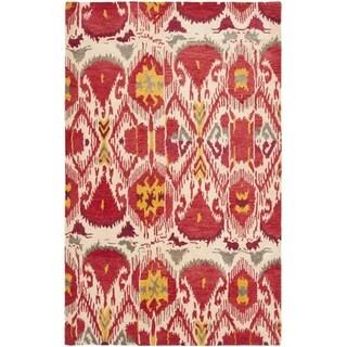 Handmade Ikat Ivory/ Red Wool Rug (5' x 8')