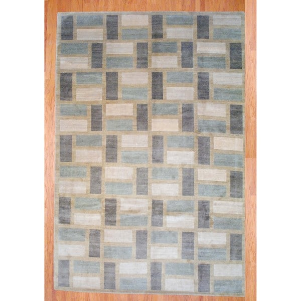 Tibetan Hand-knotted Ivory/ Beige Wool Rug (9'10 x 13'7)