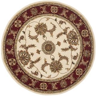Handmade Tabriz Ivory/ Red Wool Rug (6' Round)