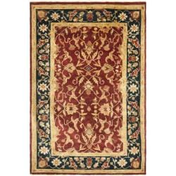Pakistani Hand-knotted Peshawar Red/ Blue Wool Rug (6' x 9')