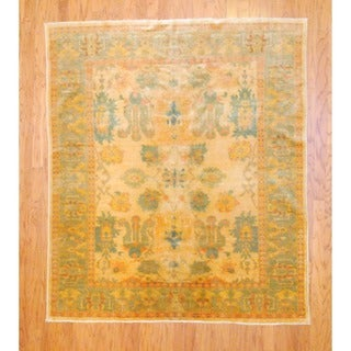 Egyptian Hand-knotted Vegetable Dye Gold/ Peach Wool Rug (5'10 x 6')