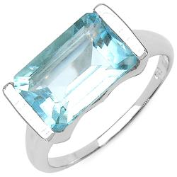 Malaika Sterling Silver Emerald-cut Blue Topaz Fashion Ring