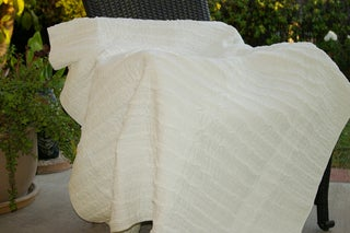 Ruffled Ivory Quilted Throw