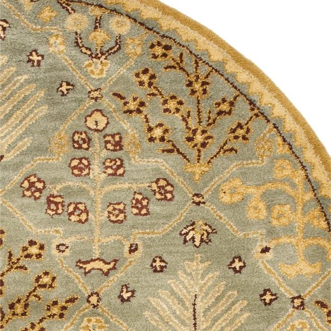 Handmade Tree of Life Slate Blue Wool Rug (4'6 x 6'6 Oval)