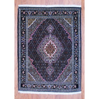 Persian Hand-knotted Tribal Tabriz Black/ Ivory Wool Rug (3'5 x 4'7)