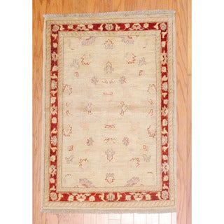 Afghan Hand-knotted Vegetable Dye Beige/ Burgundy Wool Rug (2'9 x 4')