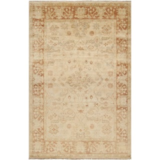 Hand-knotted Royalton Beige Wool Rug (5'6 x 8'6)