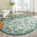 Handmade Avant-garde Floral Scrolls Ivory/ Blue Rug (7&#39; Round)
