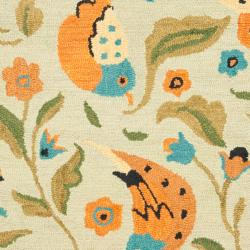 Handmade Blossom Swallow Sage Wool Rug (4' x 6')