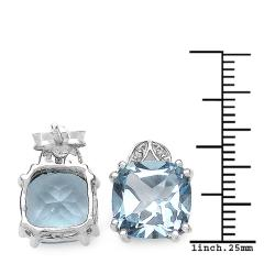 Malaika Sterling Silver Blue Topaz and 1/10ct TDW Diamond Earrings (I2-I3)