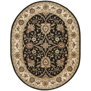 Handmade Kerman Black/ Ivory Gold Wool Rug (4'6 x 6'6 Oval)