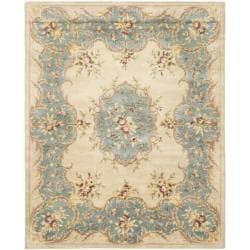 Handmade Ivory/ Light Blue Hand-spun Wool Rug (8' x 10')