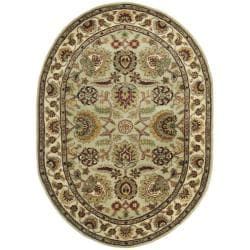 Handmade Classic Light Green/ Ivory Wool Rug (7'6 x 9'6 Oval)