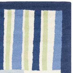 Safavieh Handmade Children's Matrix Blue New Zealand Wool Rug (5' x 8')