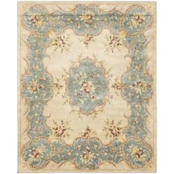 Handmade Ivory/ Light Blue Hand-spun Wool Rug (9'6 x 13'6)