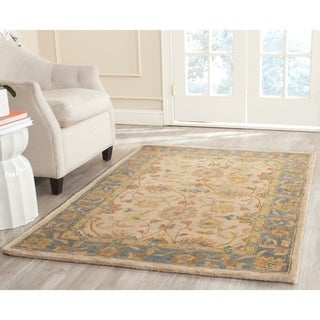 Safavieh Hand-made Anatolia Ivory/ Blue Wool Rug (6' x 9')