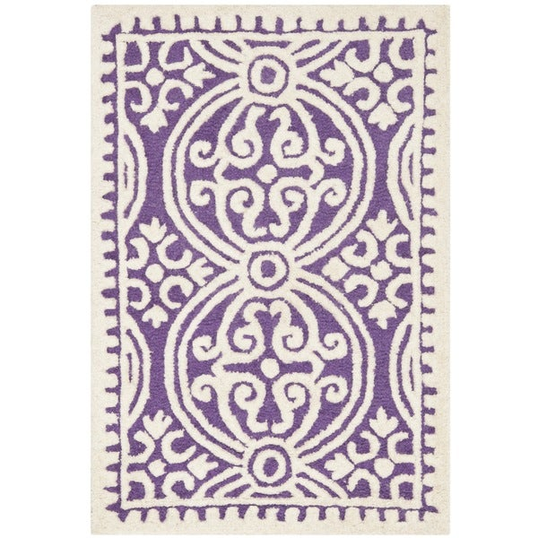 Safavieh handmade cambridge purple ivory wool accent rug for Rugs with purple accents