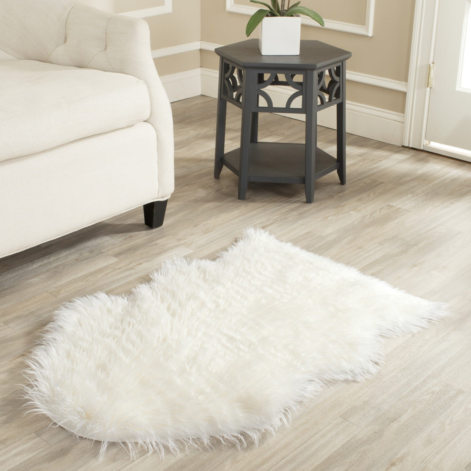 Safavieh hand made faux sheep skin ivory rug 2 39 x 3 39 overstock shopping great deals on - Faux animal skin rugs ...