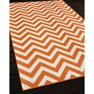 Indoor/ Outdoor Orange Chevron Rug (6'7 x 9'6)