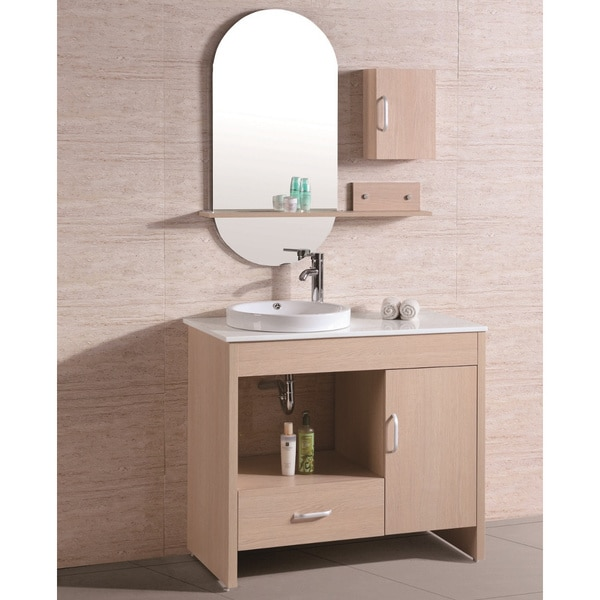 stone top single sink bathroom vanity with mirror and wall cabinet