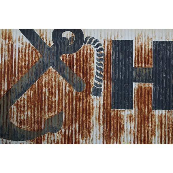 'Rusting Corrugated Metal Wall with Painted Anchor' Canvas Print