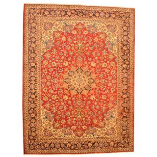 Semi-antique 1970's Persian Hand-knotted Isfahan Red/ Navy Wool Rug (9'9 x 13'1)