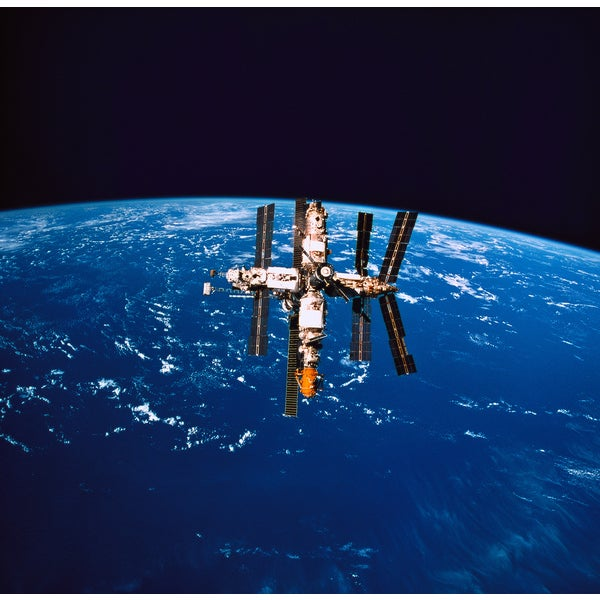 'A Space Station in Orbit above the Earth' Photography Print Canvas Wall Art