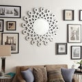 Inspire Q Nihoa Silver Interconnected Curls Sunburst Accent Wall Mirror