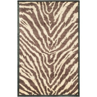 Safavieh Hand-knotted Tibetan Black/ Ivory Wool Rug (9' x 12')