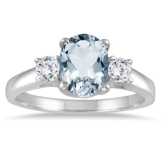 14k White Gold .25ct TDW Oval Aquamarine and Diamond Three Stone Ring