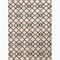 Handmade Ivory/ Black Polypropylene Easy Care Area Rug (5.3'x7.6')