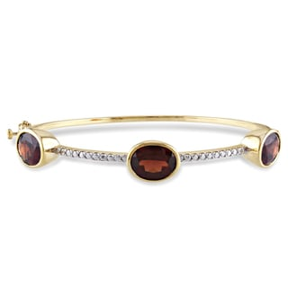 Miadora Yellowplated Silver 8 3/4ct TGW Garnet Bangle