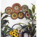 Metal Wall Decor with Six Round Plates