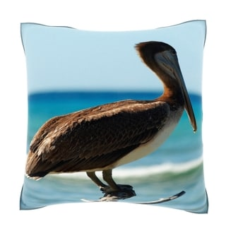 Pelican Perched on Dead Tree by Ocean Close-up 18-inch Velour Throw Pillow