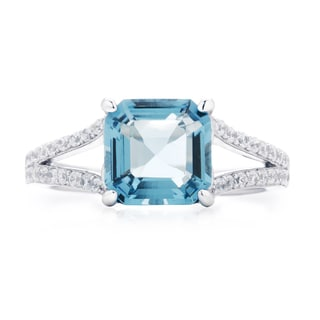 Blue Box Jewels Rhodium-plated Sterling Silver Cubic Zirconia Blue Topaz Spilt Shank Ring