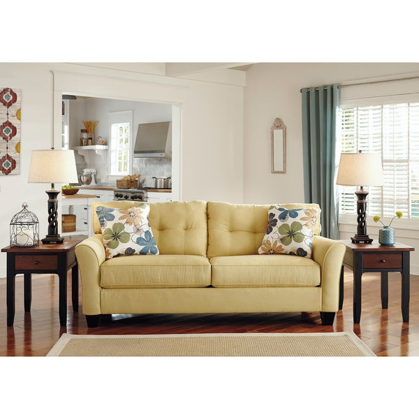 Signature design by ashley kylee goldenrod contemporary sofa and accent pillows 16116170 Ashley home furniture outlet charlotte nc