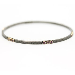 Antiqued Sterling Silver and Yellow Gold Ruby Bangle Bracelet