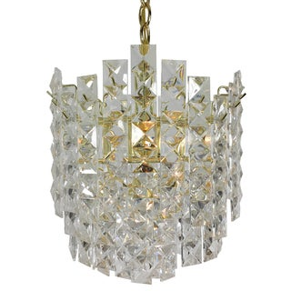 4-light Prismatic Multi-tiered roller coaster Chandelier with Brass Finish