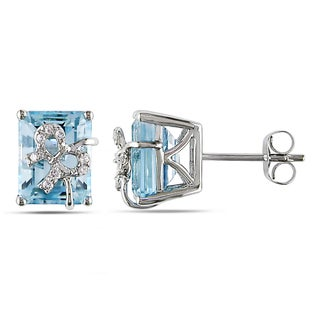 Miadora Sterling Silver 5 1/2ct TGW Blue Topaz and Diamond Accent Bow Stud Earrings with Bonus Earrings