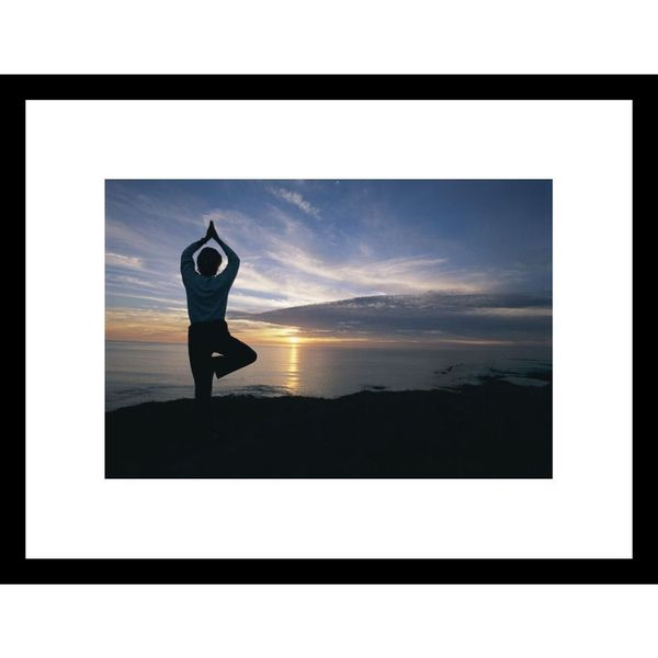 Roy Toft 'Woman in silhouette doing yoga pose on cliff at sunset' Framed Photo