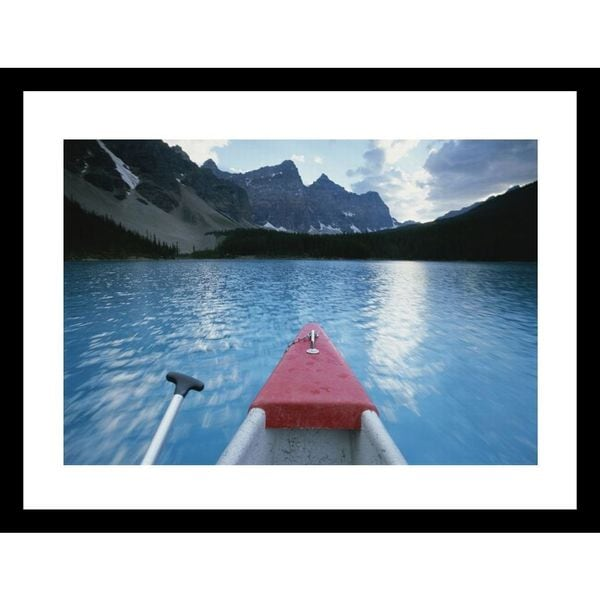 Bill Hatcher 'A canoe glides across Moraine Lake, with the Canadian Rockies ahead' Framed Photo