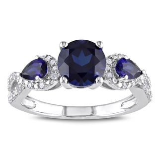 Miadora Sterling Silver Created Sapphire and 1/6ct TDW Diamond 3-stone Ring (H-I, I2-I3)