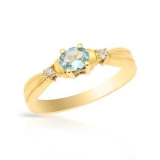 Ring with 0.23 ct TW Aquamarine and Diamonds in 18K Yellow Gold.Total item weight 2.0.