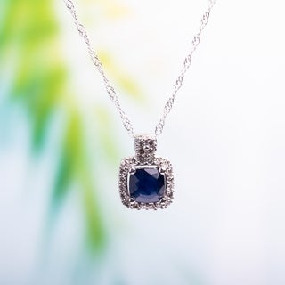 Miadora 10k White Gold Cushion-cut Sapphire and 1/10ct TDW Diamond Halo Necklace (G-H, I1-I2)