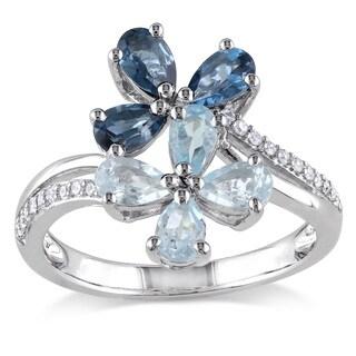Miadora Sterling Silver Blue Topaz and 1/10ct TDW Diamond Flower Ring (H-I, I2-I3)