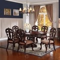 Freeport Brown 7-piece Pedestal Extending Oval Table Dining Set