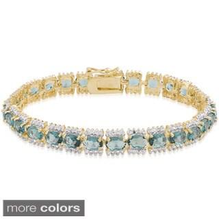 Dolce Giavonna Gold Overlay Simulated London Blue Topaz Bracelet
