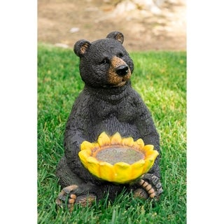 Black Bear Sitting with Sunflower Birdfeeder